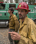 Fire Capt. from the Engine 345, Stanislaus National Forest. After hearing the news that the South Fork Fire was 1/4 mile from Wawona, I went back to the fire to see what was happening.  Most of the fire activity last night and this morning early were near Chilnualna Falls Road.  It looked to me that the firefighters had done their jobs.   Structure protection was in place with lots of engine and hose lays all over the place.  I decided to photograph Firefighters today Monday, August 21, 2017.  Photo by Al Golub/Golub Photography.