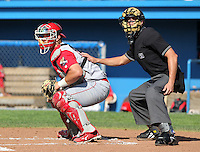Williamsport Crosscutters catcher Cameron Rupp (50) and home plate umpire Shane Livensparger watch a hit during a game vs the Batavia Muckdogs at Dwyer Stadium in Batavia, New York July 25, 2010.   Batavia defeated Williamsport 8-1.  Photo By Mike Janes/Four Seam Images