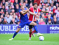 Lincoln City's Bruno Andrade battles with Sunderland's Laurens De Bock<br /> <br /> Photographer Andrew Vaughan/CameraSport<br /> <br /> The EFL Sky Bet League One - Lincoln City v Sunderland - Saturday 5th October 2019 - Sincil Bank - Lincoln<br /> <br /> World Copyright © 2019 CameraSport. All rights reserved. 43 Linden Ave. Countesthorpe. Leicester. England. LE8 5PG - Tel: +44 (0) 116 277 4147 - admin@camerasport.com - www.camerasport.com
