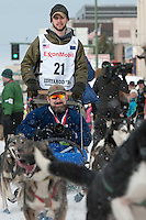 Noah Pereira and team leave the ceremonial start line with an Iditarider at 4th Avenue and D Street in downtown Anchorage, Alaska on Saturday, March 5th during the 2016 Iditarod race. Photo by Joshua Borough/SchultzPhoto.com