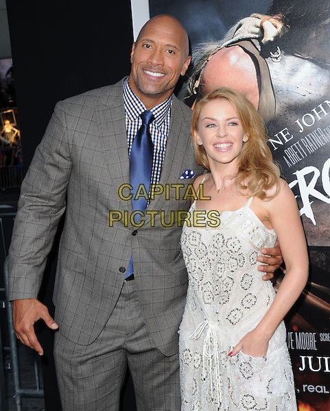 Dwayne Johnson and Kylie Minogue attends The Paramount Pictures L.A. Premiere of Hercules held at The TCL Chinese Theatre in Hollywood, California on July 23,2014 <br /> CAP/DVS<br /> &copy;DVS/Capital Pictures