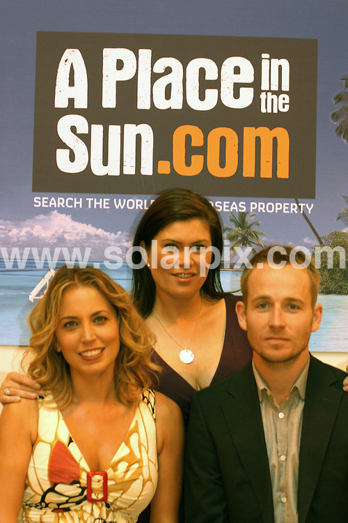 """**ALL ROUND PICTURES FROM SOLARPIX.COM**.**WORLDWIDE SYNDICATION RIGHTS**.Channel 4 TV's """"A Place in the Sun"""" exhibition at the NEC in Birmingham, UK. Saturday 27th September 2008..This pic: Jasmin Harman, Amanda Lamb & Johnny Irwin..JOB REF: 7482 NYA     DATE: 27_09_2008.**MUST CREDIT SOLARPIX.COM OR DOUBLE FEE WILL BE CHARGED* *UNDER NO CIRCUMSTANCES IS THIS IMAGE TO BE REPRODUCED FOR ANY ONLINE EDITION WITHOUT PRIOR PERMISSION*"""