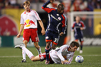 New England Revolution midfielder Sainey Nyassi (31) fights through a tackle by New York Red Bulls defender Kevin Goldthwaite (2). The New York Red Bulls and the New England Revolution played to a 1-1 tie during a Major League Soccer match at Giants Stadium in East Rutherford, NJ, on April 19, 2008.