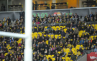 Fans, including Prince Harry, watch the Super Rugby match between the Hurricanes and Sharks at Westpac Stadium, Wellington, New Zealand on Saturday, 9 May 2015. Photo: Dave Lintott / lintottphoto.co.nz