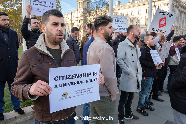 Kurds protest outside Parliament over Home Office confiscation of their passports and refusal to grant them refugee status.