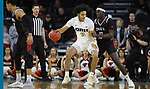 SIOUX FALLS, SD - MARCH 8: Kevin Obanor #0 of the Oral Roberts Golden Eagles pivots and drives to the basket against Wanjang Tut #13 of the Nebraska-Omaha Mavericks at the 2020 Summit League Basketball Championship in Sioux Falls, SD. (Photo by Richard Carlson/Inertia)
