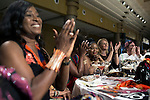 LAGOS, NIGERIA – DECEMBER 5: Guests cheer a show  during the Africa International Fashion Week in the Lagos Oriental Hotel, Nigeria 2014 (Photo by: Per-Anders Pettersson)