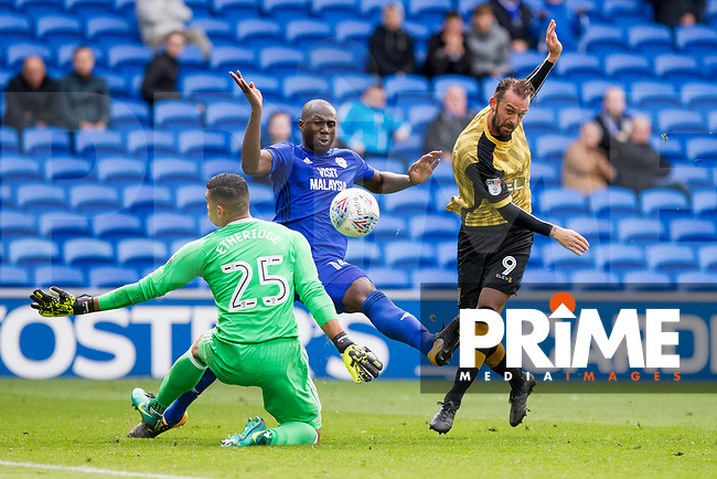 Steven Fletcher of Sheffield Wednesday shoots at goal under pressure from Sol Bamba and Neil Etheridge of Cardiff City during the Sky Bet Championship match between Cardiff City and Sheffield Wednesday at Cardiff City Stadium, Cardiff, Wales on 16 September 2017. Photo by Mark  Hawkins / PRiME Media Images.