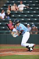 Hickory Crawdads Sam Huff (24) connects on a pitch during a game with the Asheville Tourists at L.P. Frans Stadium on May 8, 2019 in Hickory, North Carolina. The Tourists defeated the Crawdads 7-6. (Tracy Proffitt/Four Seam Images)
