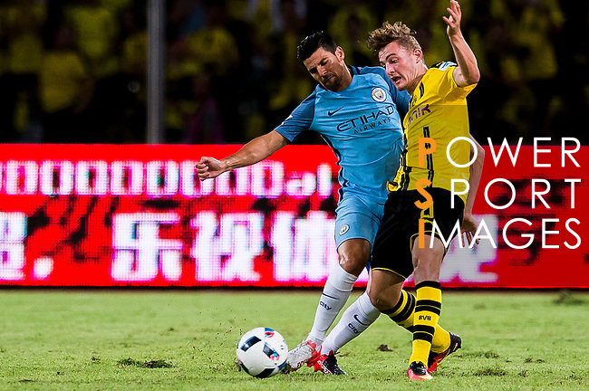 SHENZHEN - JULY 28: Manchester City striker Nolito Agudo (l) contests the ball against Borussia Dortmund midfielder Jacob Bruun Larsen (r) during the match between Borussia Dortmund vs Manchester City FC at the 2016 International Champions Cup China match at the Shenzhen Stadium on 28 July 2016 in Shenzhen, China. (Photo by Power Sport Images/Getty Images)