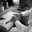 "Jose ""El Nino"" Temprana rolling a cigar in his workshop."