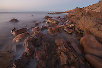 A long exposure at twilight emphasizes the contrast between rocks and ocean at Hallett Cove, Adelaide, South Australia.