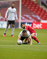 7th July 2020; City Ground, Nottinghamshire, Midlands, England; English Championship Football, Nottingham Forest versus Fulham; Harry Arter of Fulham is brought down by Tiago Silva of Notts Forest