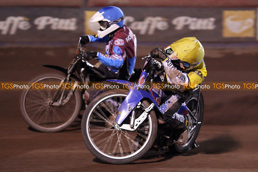 Heat 6: Josh Auty (yellow) and Stuart Robson (blue) - Lakeside Hammers vs Coventry Bees, Elite League Speedway at the Arena Essex Raceway, Purfleet - 09/04/10 - MANDATORY CREDIT: Rob Newell/TGSPHOTO - Self billing applies where appropriate - 0845 094 6026 - contact@tgsphoto.co.uk - NO UNPAID USE.