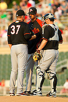 Delmarva Shorebirds pitching coach Troy Mattes #20 has a chat with his pitcher Jarret Martin #37 and catcher Justin Dalles #9 during the game against the Kannapolis Intimidators at Fieldcrest Cannon Stadium on May 21, 2011 in Kannapolis, North Carolina.   Photo by Brian Westerholt / Four Seam Images