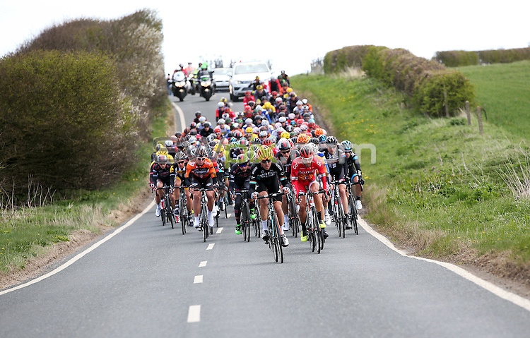 Picture by Alex Whitehead/SWpix.com - 01/05/2015 - Cycling - 2015 Tour de Yorkshire: Stage 1, Bridlington to Scarborough - The Peleton makes their way out of Bridlington at the start of Stage 1.
