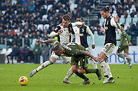 6th January 2020; Allianz Stadium, Turin, Italy; Serie A Football, Juventus versus Cagliari; Radja Nainggolan of Cagliari is caught in a sandwich between Aaron Ramsey and Adrien Rabiot of Juventus - Editorial Use
