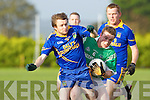 Eoin Cronin Spa and Margus Mangan Milltown collide during their county league game in Milltown on Saturday evening