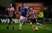 Lincoln City's Tom Pett under pressure from Exeter City's Kane Wilson<br /> <br /> Photographer Chris Vaughan/CameraSport<br /> <br /> The EFL Sky Bet League Two - Lincoln City v Exeter City - Tuesday 26th February 2019 - Sincil Bank - Lincoln<br /> <br /> World Copyright © 2019 CameraSport. All rights reserved. 43 Linden Ave. Countesthorpe. Leicester. England. LE8 5PG - Tel: +44 (0) 116 277 4147 - admin@camerasport.com - www.camerasport.com