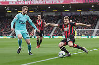 Bournemouth's Ryan Fraser (right) under pressure from Newcastle United's Florian Lejeune (left) <br /> <br /> Photographer David Horton/CameraSport<br /> <br /> The Premier League - Bournemouth v Newcastle United - Saturday 16th March 2019 - Vitality Stadium - Bournemouth<br /> <br /> World Copyright © 2019 CameraSport. All rights reserved. 43 Linden Ave. Countesthorpe. Leicester. England. LE8 5PG - Tel: +44 (0) 116 277 4147 - admin@camerasport.com - www.camerasport.com