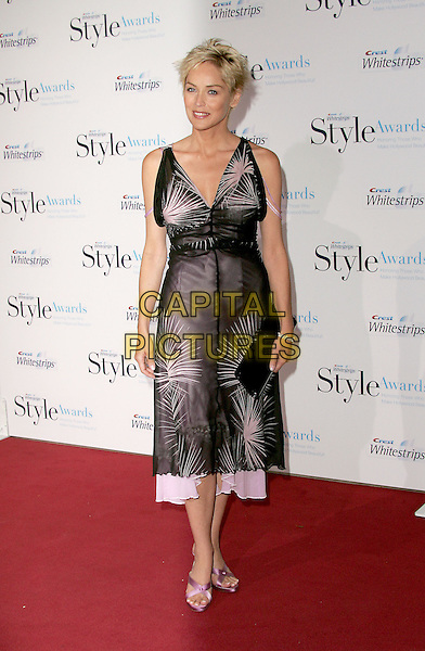SHARON STONE.The 1st Annual Crest White Strips Style Awards held at The Beverly Hills Hotel in Beverly Hills, California .June 16,2004.full length, full-length, sheer, silk, satin, plunging neckline, lilac, sandals, black handbag, clutch purse.www.capitalpictures.com.sales@capitalpictures.com.©Capital Pictures