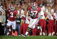 Jan 7, 2010; Pasadena, CA, USA; Alabama Crimson Tide defensive lineman Marcell Dareus (57) returns an interception return for a touchdown during the second quarter of the 2010 BCS national championship game against the Texas Longhorns at the Rose Bowl.  Mandatory Credit: Gary A. Vasquez-