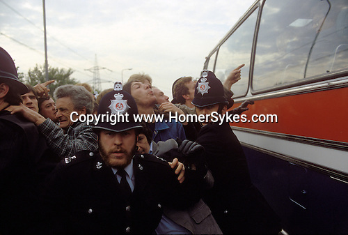 Isle of Grain Kent Power Station dispute Flying Pickets Circa 1985  Coach of workers being bused in through a picket line.