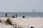 Fishing off the beach in Morgan, gas rigs in the Gulf of Mexico