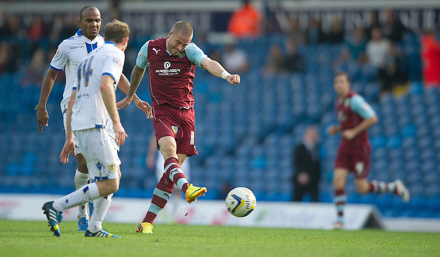 Burnley's Michael Kightly drives this shot just wide watched by Leeds United's Aidan White<br /> <br /> Photo by Stephen White/CameraSport<br /> <br /> Football - The Football League Sky Bet Championship - Leeds United v Burnley - Saturday 21st September 2013 - Elland Road - Leeds<br /> <br /> &copy; CameraSport - 43 Linden Ave. Countesthorpe. Leicester. England. LE8 5PG - Tel: +44 (0) 116 277 4147 - admin@camerasport.com - www.camerasport.com