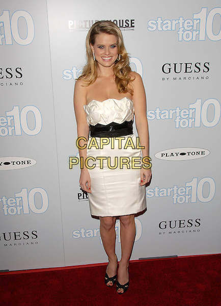 "ALICE EVE.Attends The L.A. Premiere of ""Starter For 10"" held at The Arclight Theatre in Hollywood, California, USA,.February 06 2007.full length Strapless white dress black waist belt shoes.CAP/DVS.©Debbie VanStory/Capital Pictures"