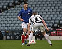 Lee Wallace takes on Michael Keenan in the Queen's Park v Rangers Irn-Bru Scottish League Division Three match played at Hampden Park, Glasgow on 29.12.12.