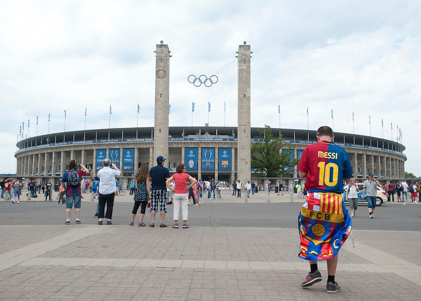 A Barcelona fan, wearing a replica shirt bearing the name of Barcelona's Lionel Messi, walks towards the Olympiastadion ahead of the Champions League Final<br /> <br /> Photographer Chris Vaughan/CameraSport<br /> <br /> Football - UEFA Champions League Final - Juventus v Barcelona - Saturday 6th June 2015 - Olympiastadion - Berlin, Germany<br /> <br /> &copy; CameraSport - 43 Linden Ave. Countesthorpe. Leicester. England. LE8 5PG - Tel: +44 (0) 116 277 4147 - admin@camerasport.com - www.camerasport.com
