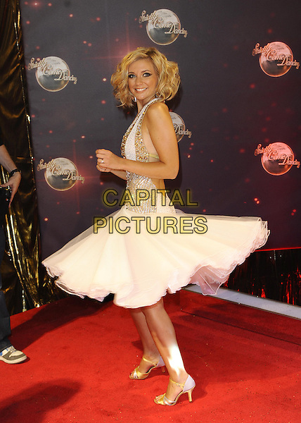 Rachel Riley<br /> The red carpet launch for 'Strictly Come Dancing' at Elstree Studios, Borehamwood, England.<br /> September 3rd, 2013<br /> full length gold white dress side spinning twirling <br /> CAP/FIN<br /> &copy;Steve Finn/Capital Pictures