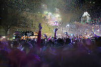 Sixth Street Patrons celebrate the New Year Countdown as a ball and confetti drop on the 6th Street Entertainment District in Austin, Texas.