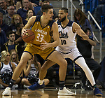California Baptist center Zach Pirog (33) drives on Nevada forward Caleb Martin (10) in the second half of an NCAA college basketball game in Reno, Nev., Monday, Nov. 19, 2018. (AP Photo/Tom R. Smedes)