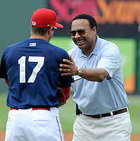 "Spartanburg Magistrate court judge Karry Guillory, a colon cancer survivor, greets Drive infielder Garin Cecchini (17) after throwing out the first pitch for colon cancer awareness Sunday at Fluor Field at the West End. It was ""Drive Out Colon Cancer"" day at the Greenville Drive game sponsored by BlueCross BlueShield of South Carolina. The Drive lost to intrastate rival Charleston RiverDogs, 7-5. (Tom Priddy/Four Seam Images)"