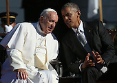 U.S. President Barack Obama (R) confers with Pope Francis (L) during an arrival ceremony at the White House on September 23, 2015 in Washington, DC. The Pope begins his first trip to the United States at the White House followed by a visit to St. Matthew's Cathedral, and will then hold a Mass on the grounds of the Basilica of the National Shrine of the Immaculate Conception. <br /> Credit: Win McNamee / Pool via CNP
