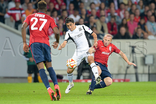 18.09.2014. Lille, France. Europa League football group stages. Lille versus Krasnodar.  Florent BALMONT (lille) challenges Odil Ahmedov (Krasnodar)