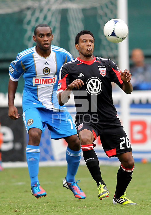 WASHINGTON, D.C. - AUGUST 19, 2012:  Lionard Pajoy (26) of DC United keeps the ball from Michael Lahoud (13) of the Philadelphia Union during an MLS match at RFK Stadium, in Washington DC, on August 19. The game ended in a 1-1 tie.