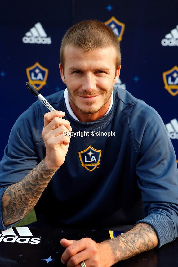 HONG KONG, CHINA-MARCH 07: David Beckham signing an autograph by Sharpie fine point marker in Hong Kong.