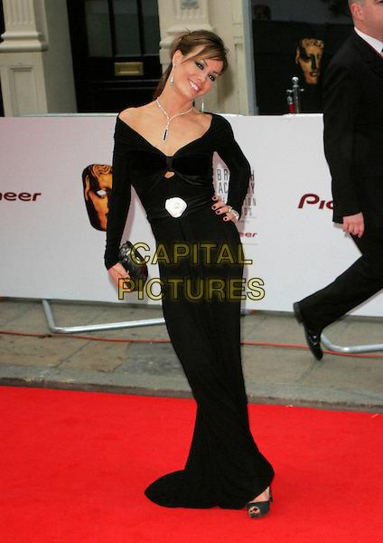 TARA PALMER-TOMKINSON .Red Carpet Arrivals at The British Academy Television Awards (BAFTA's) Sponsored by Pioneer, held at the London Palladium, London, England, May 20th 2007. .full length black dress TPT Palmer Tomkinson maxi long hand on hip low cut white rose flower corsage.CAP/AH.©Adam Houghton/Capital Pictures.