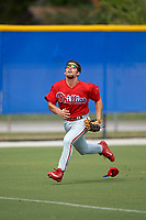 Philadelphia Phillies left fielder Austin Listi (24) loses his hat while tracking down a fly ball during an Instructional League game against the Toronto Blue Jays on October 7, 2017 at the Englebert Complex in Dunedin, Florida.  (Mike Janes/Four Seam Images)