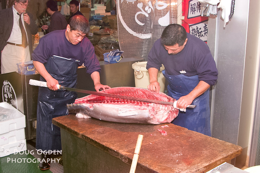 Carefully maximizing the  tuna. Outside the Tsukiji fish market, Tokyo Japan
