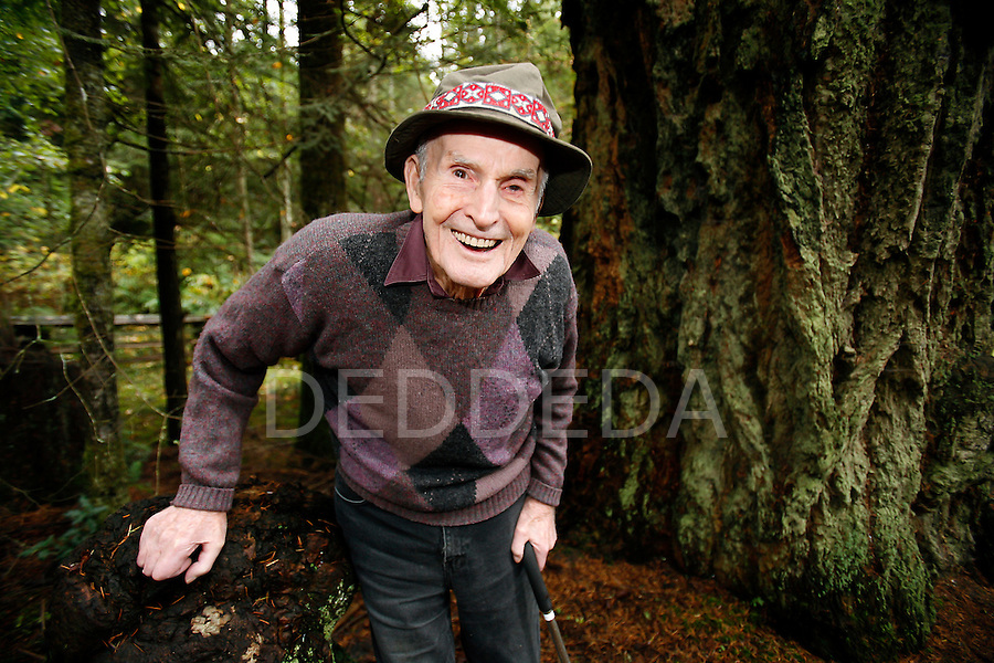 Merve Wilkinson,92, stands next to a 1000 year-old Douglas fir tree on his 77-acre property near Cedar, British Columbia. Wilkinson, who is often called the Moses of eco-forestry in Canada, has been selectively logging his property for six decades. He is receiving an honorary degree from the University of Victoria.