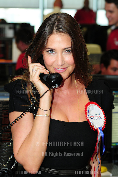 Lisa Snowdon takes to the trading floor at BGC in Canary Wharf as part of the fundraising day set up after the 9/11 terrorist attacks. 12/09/2011 Picture by: Simon Burchell / Featureflash