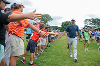 Brooks Koepka (USA) high fives fans enroute to the 5th tee during Friday's round 2 of the PGA Championship at the Quail Hollow Club in Charlotte, North Carolina. 8/11/2017.<br /> Picture: Golffile | Ken Murray<br /> <br /> <br /> All photo usage must carry mandatory copyright credit (&copy; Golffile | Ken Murray)