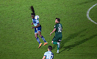Marcus Bean of Wycombe Wanderers heads clear of Graham Carey of Plymouth Argyle during the Sky Bet League 2 match between Wycombe Wanderers and Plymouth Argyle at Adams Park, High Wycombe, England on 14 March 2017. Photo by Andy Rowland / PRiME Media Images.