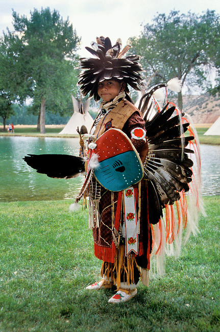 Young traditional male Shoshone dancer dressed in traditional regalia during the Gift of the Waters pageant at the Thermopolis Hot Springs in Wyoming