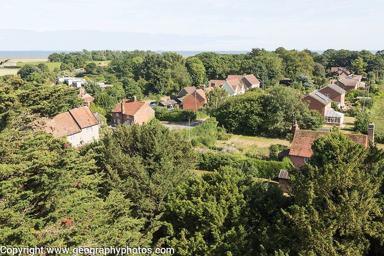 North Sea village landscape over trees in summer at Bawdsey, Suffolk, England, UK view from church tower
