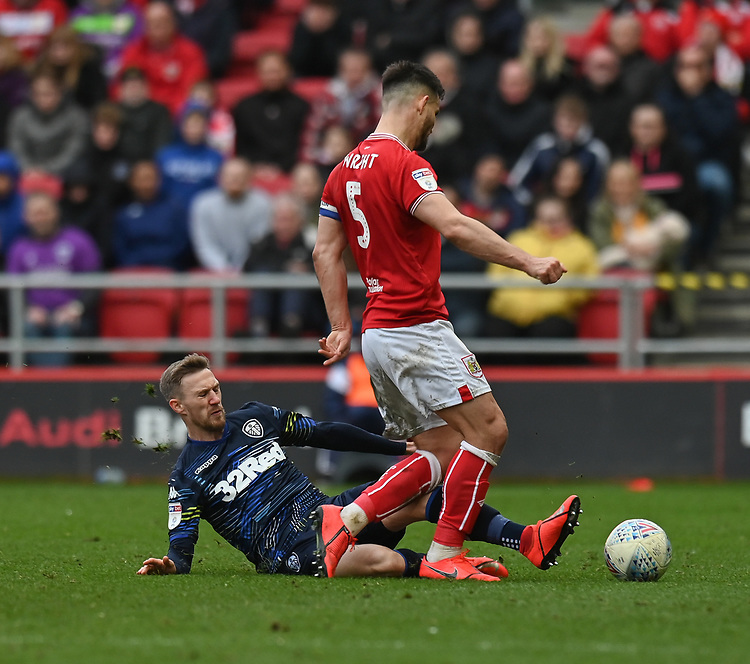 Bristol City's Bailey Wright (right) is tackled by Leeds United's Barry Douglas (left) <br /> <br /> Photographer David Horton/CameraSport<br /> <br /> The EFL Sky Bet Championship - Bristol City v Leeds United - Saturday 9th March 2019 - Ashton Gate Stadium - Bristol<br /> <br /> World Copyright © 2019 CameraSport. All rights reserved. 43 Linden Ave. Countesthorpe. Leicester. England. LE8 5PG - Tel: +44 (0) 116 277 4147 - admin@camerasport.com - www.camerasport.com